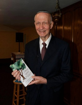 yitz holding our book